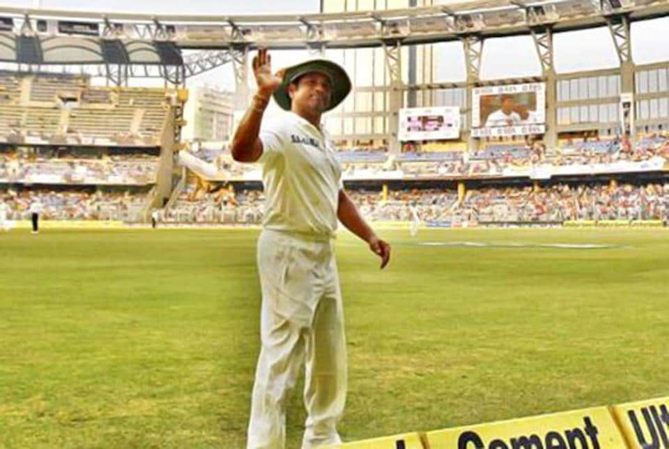 Sachin Tendulkar waves at the crowd during his final Test at Wankhede Stadium. (PTI Photo)