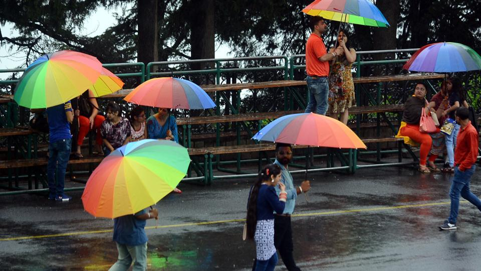 Tourists with colourful umbrellas at the Lakkar Bazaar.