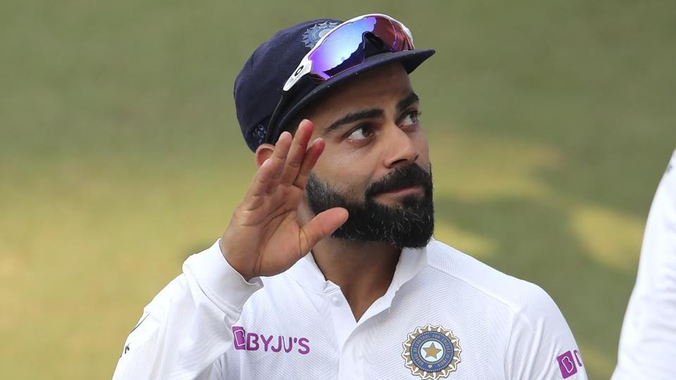 India's captain Virat Kohli acknowledges the applause from the spectators.