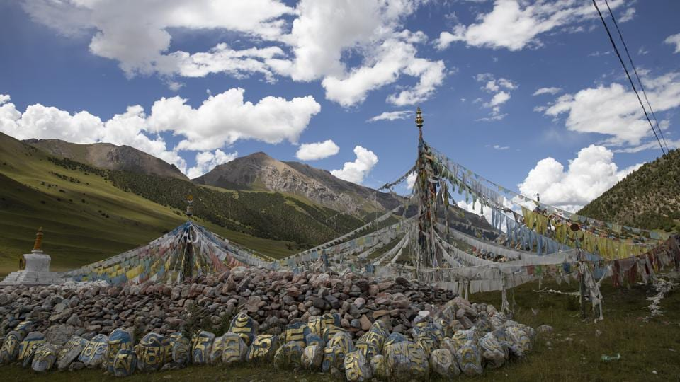 Tibetan prayer flags are seen during a clear day in Angsai, inside the Sanjiangyuan region in western China's Qinghai province. Qinghai is a vast region in western China adjoining Tibet and shares much of its cultural legacy. In August, policymakers and scientists from China, the US and other countries convened in Xining, capital of Qinghai province, to discuss China's plans to create a unified system with clear standards for limiting development and protecting ecosystems. (Ng Han Guan / AP)