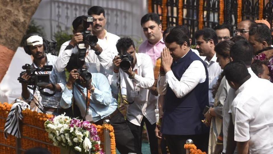 BJP leader Devendra Fadnavis pays tributes to Shiv Sena founder Bal Thackeray at his memorial at Mumbai's Shivaji Park on Sunday.