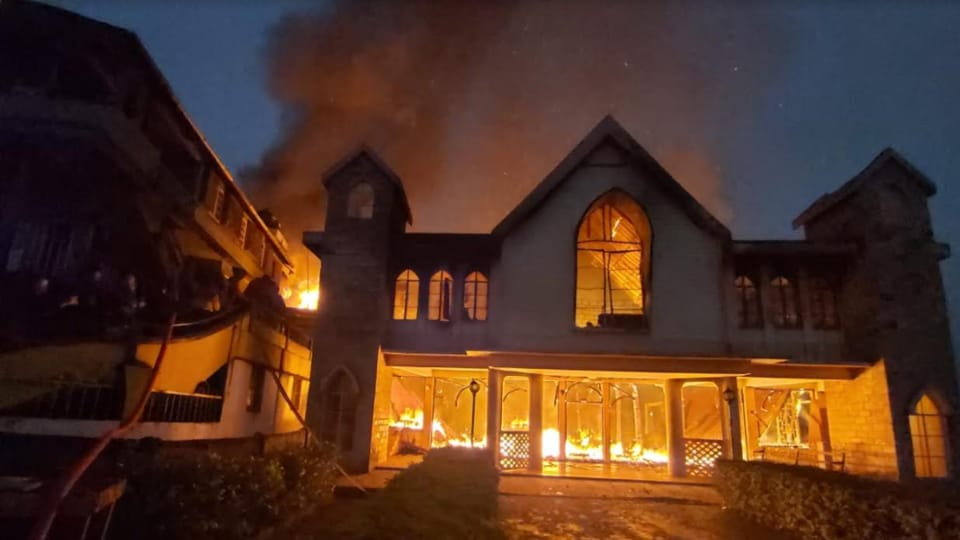 Fire engulfing the Church of Good building in Qualapatty area of Shillong on Sunday morning.