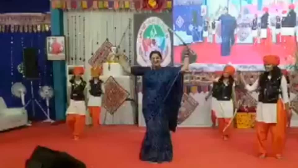 Smriti Irani performing Talwar Rass using two swords.