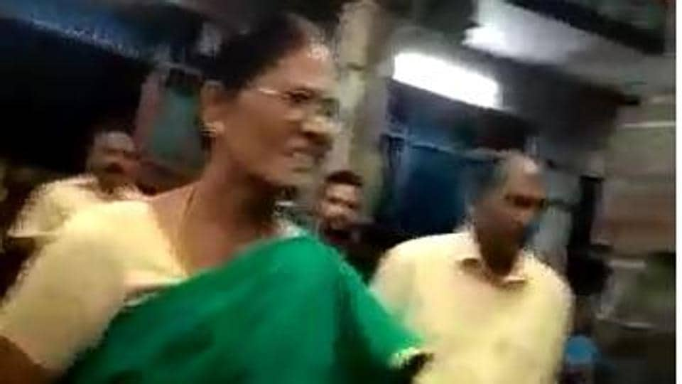 A video shot by a devotee shows Dharshan alleging that Latha was trying to rob his gold chain.