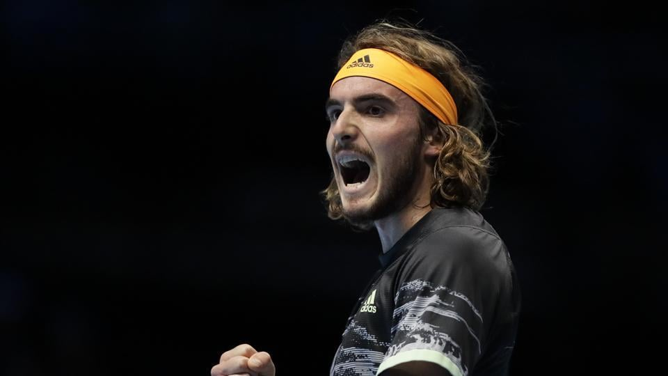 Stefanos Tsitsipas of Greece celebrates winning a point against Roger Federer of Switzerland during their ATP World Tour Finals semifinal tennis match at the O2 Arena in London, Saturday, Nov. 16, 2019.