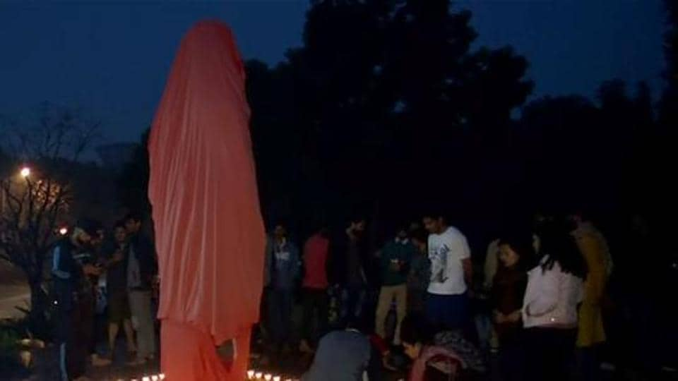 The statue of Swami Vivekananda, which was to be unveiled inside the campus, was found defaced with slogans and graffiti painted on its base by unknown miscreants.