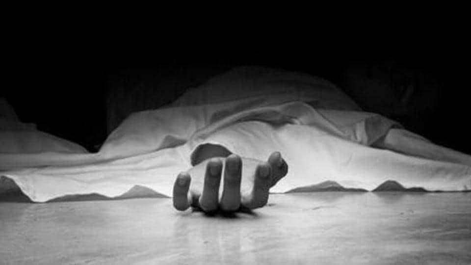 The dead man's body. Focus on hand