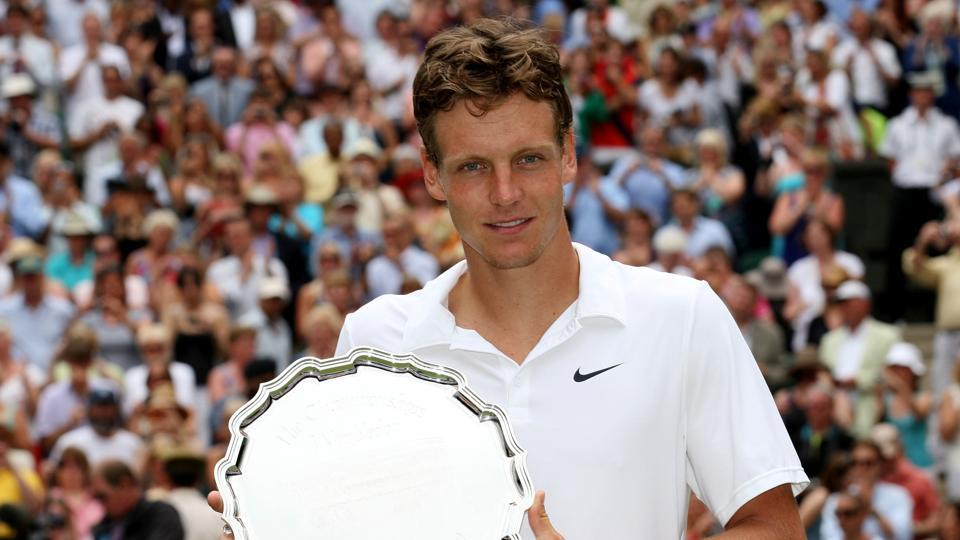 FILE PHOTO: Czech Republic's Tomas Berdych poses with a trophy.