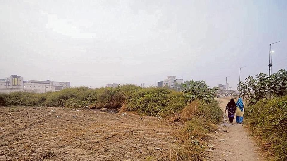 Two women walk past a crime spot of an alleged gang rape, in Noida on Friday.