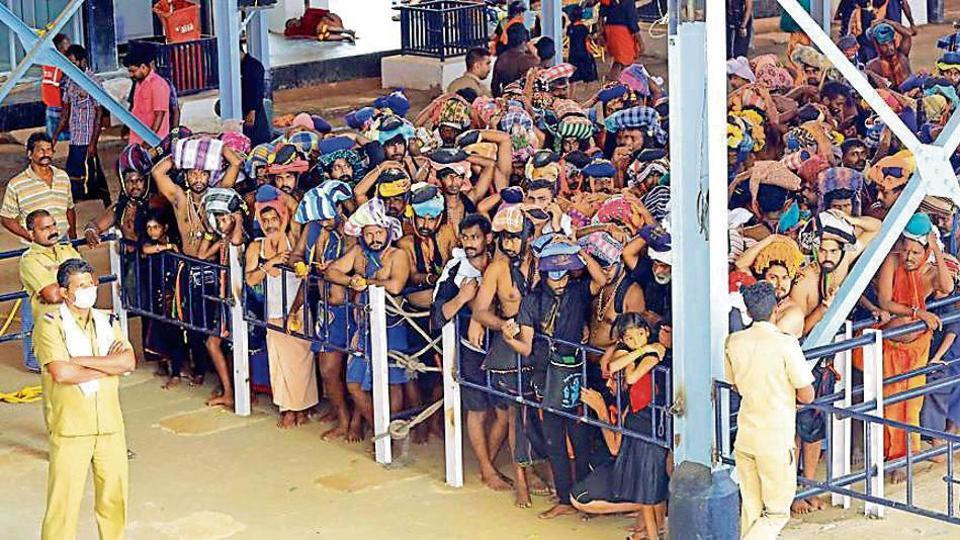 Devotees stand in queues to offer prayers at Lord Ayyappa temple at the Sabarimala temple in Kerala on Sunday, November 17, 2019.