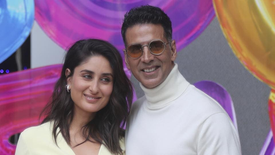 Bollywood actors Akshay Kumar, right, along with Kareena Kapoor pose for photographs during the trailer launch of their upcoming film Good Newwz in Mumbai.