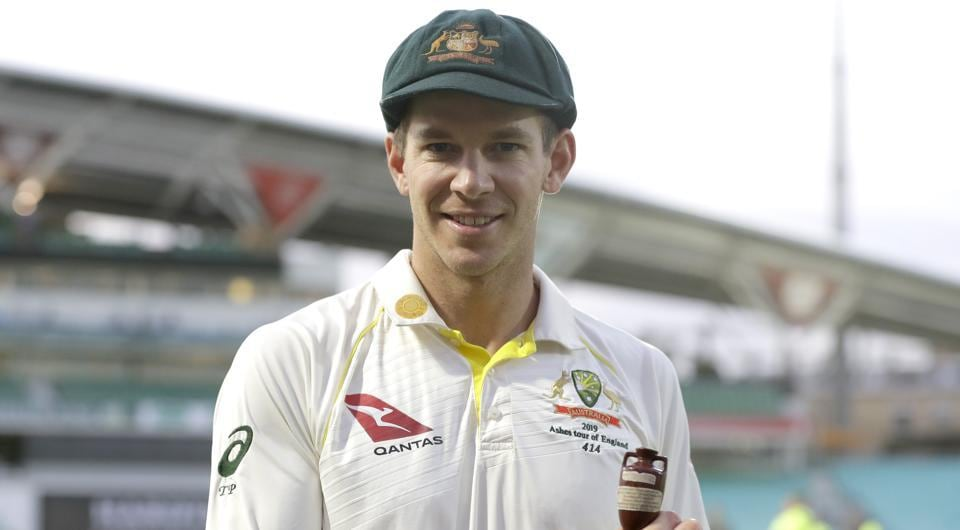 Australia's Tim Paine poses with the Ashes Urn during a presentation ceremony.