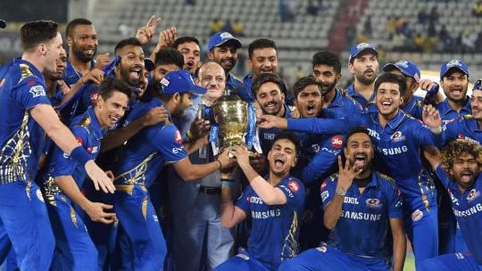 Mumbai Indians (MI) skipper Rohit Sharma with his teammates celebrating with Indian Premier League 2019 winning trophy.