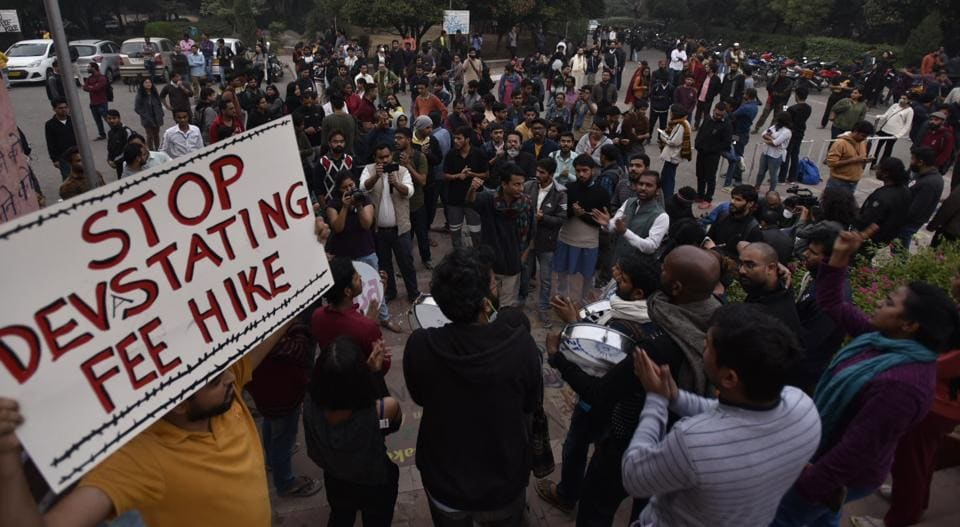 Students hold placards and raise slogans to protest against the administration's move to hike the hostel fee, at Jawaharlal Nehru University (JNU), in New Delhi, India, on Friday, November 15, 2019.