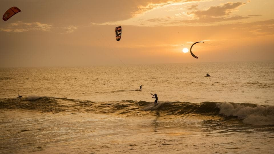 Kitesurfers riding at sunset at Dakhla beach in Western Sahara. In the heart of disputed Western Sahara, a former garrison town has become an unlikely tourist magnet after kitesurfers discovered the windswept desert coast was perfect for their sport. In Dakhla, an Atlantic seaport town punctuated with military buildings in Western Sahara, swarms of kitesurfers now sail in the lagoon daily. (FADEL SENNA / AFP)