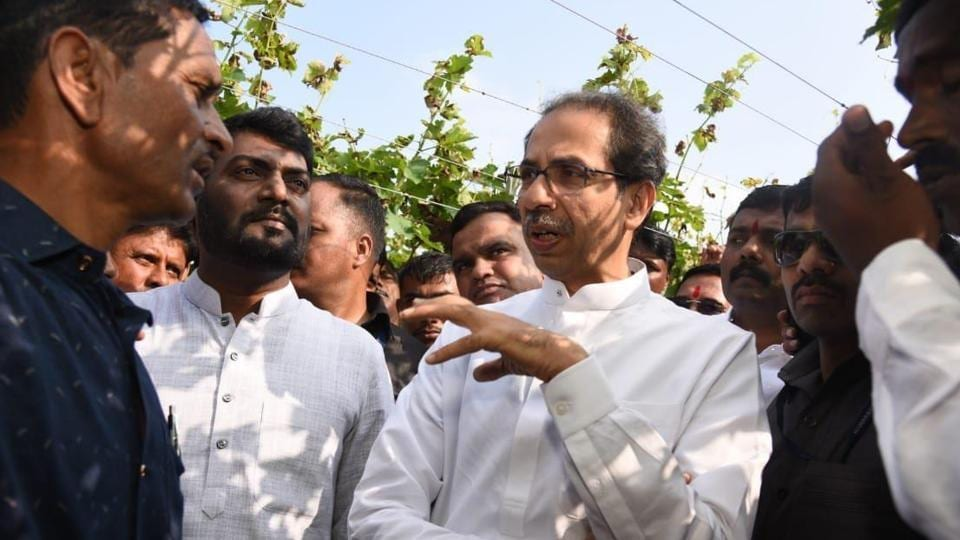 Shiv Sena chief Uddhav Thackeray speaks to farmers during a visit to drought affected areas in Satara.