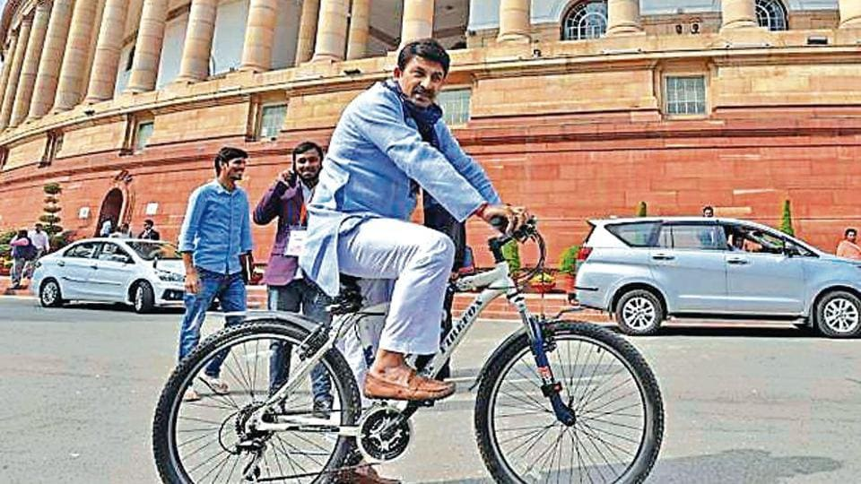 BJP MP Manoj Tiwari arrives for the winter session on a bicycle on Monday.