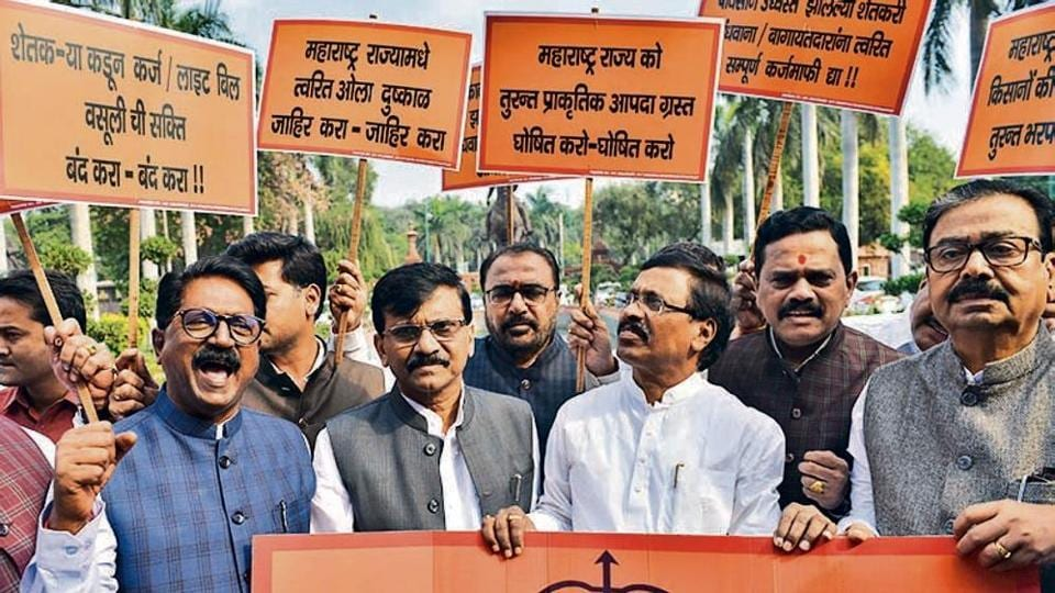 Shiv Sena MPs Sanjay Raut, Arvind Sawant (L) and others protest at Parliament