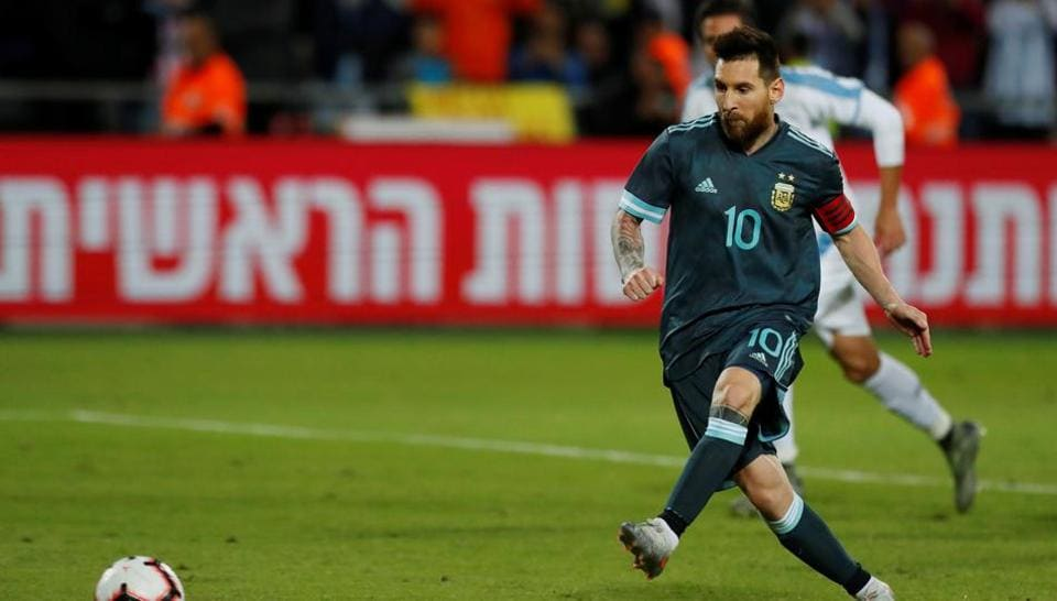 Argentina's Lionel Messi scores their second goal from the penalty spot