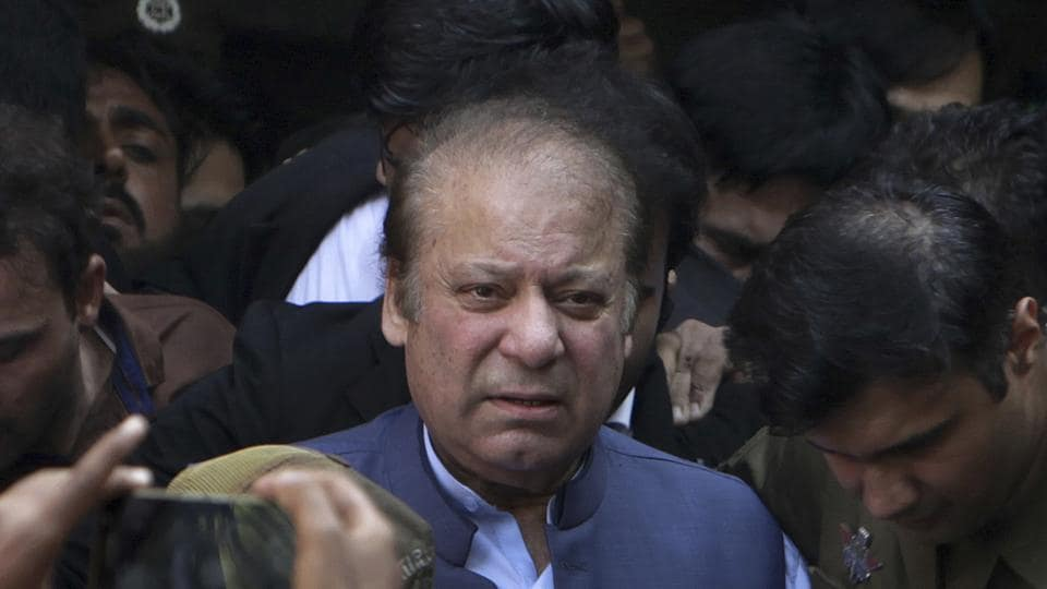 In this Oct. 8, 2018, file photo, former Pakistani Prime Minister Nawaz Sharif leaves after appearing in a court in Lahore, Pakistan. Sharif, who was convicted of corruption, has left the country and is traveling to London for medical treatment.