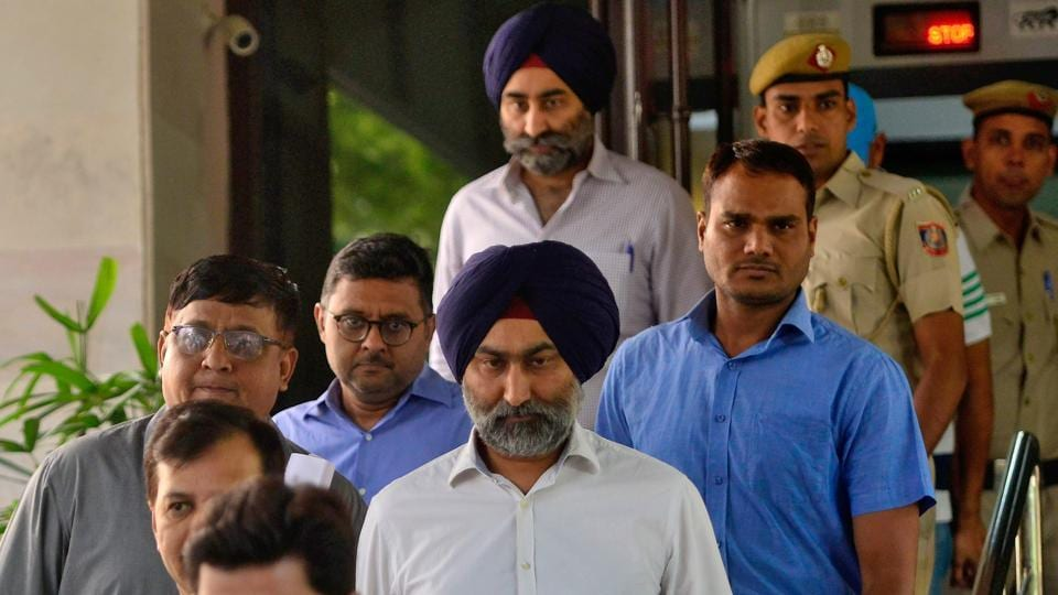Former Ranbaxy Labs directors Malvinder Singh and Shivinder Singh being taken to a court in New Delhi in October.
