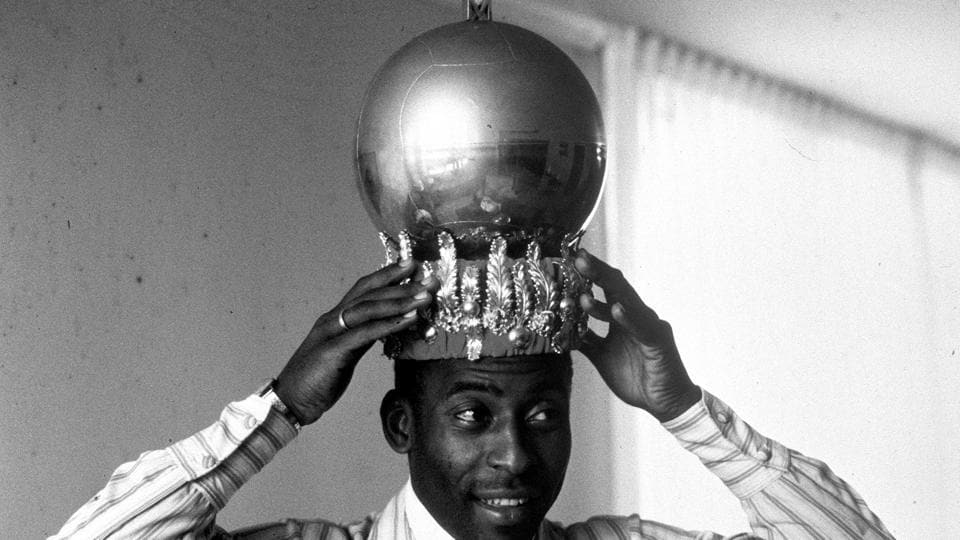 Brazil's Pele displays a crown presented to him after scoring his 1,000th goal.