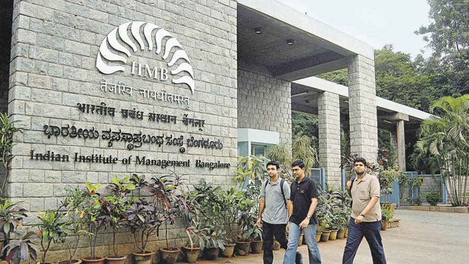 Students walk past the Indian Institute of Management campus in Bangalore.