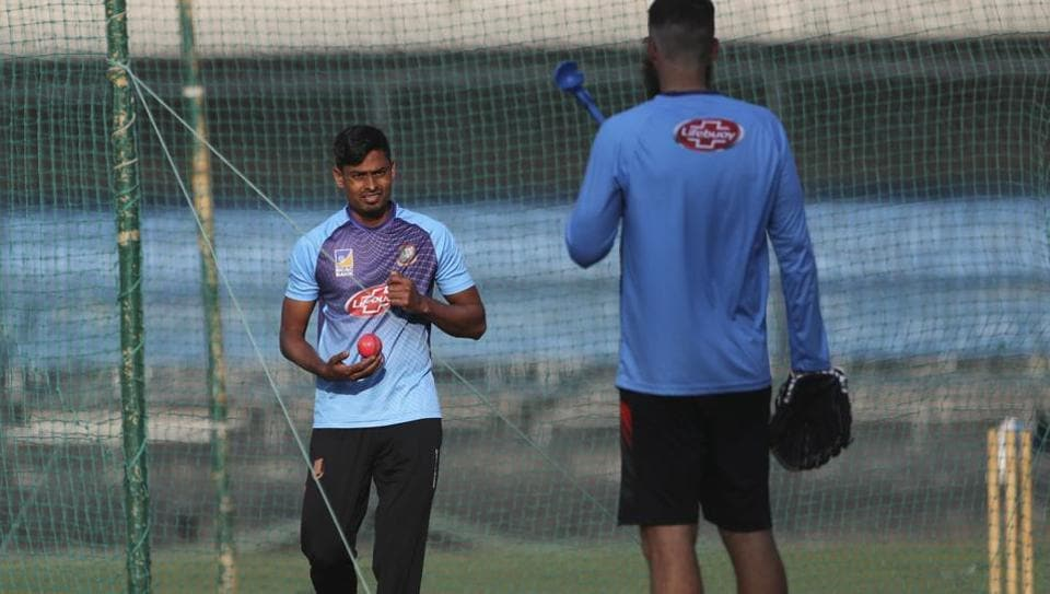Bangladesh's Taijul Islam, left, holds a pink ball as he listens to bowling coach Daniel Vettori during a training session
