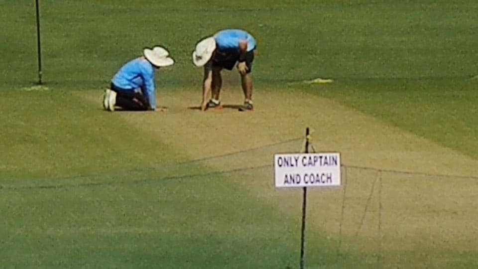 Officials inspecting the Eden Gardens pitch.