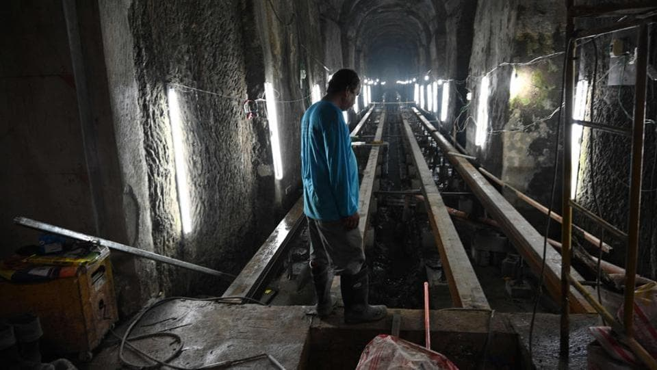 A worker stands near the entrance of the El Deposito, a Spanish-era water reservoir being rehabilitated for tourism, in San Juan town, Manila. Vaulted ceilings and rows of stone columns stretch into the humid darkness deep below the Philippine capital, where workers are transforming a more than century-old underground reservoir into a draw for tourists. (Ted ALJIBE / AFP)