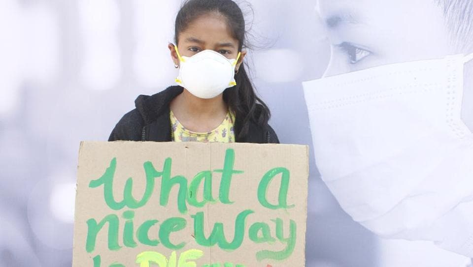 A child at the protest against growing air pollution in Gurugram, at Leisure Valley Park, Sector 29, in Gurugram,  on Sunday, November 17, 2019.