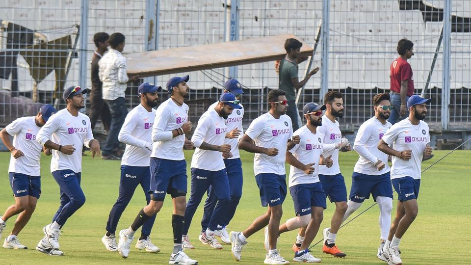 Indian cricket captain Virat Kohli and others during a training session.