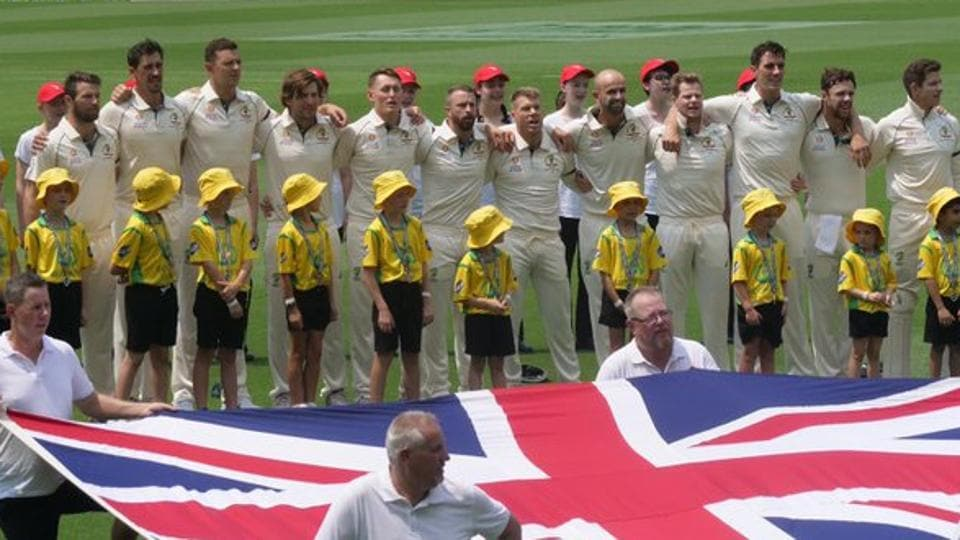 Australian cricket team stands for national anthem.