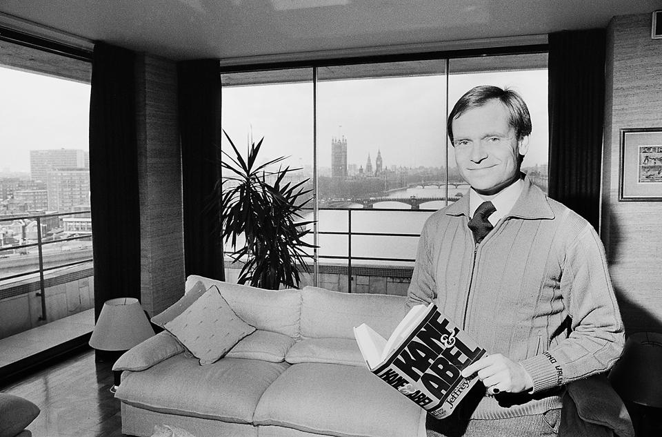 Jeffrey Archer holding a copy of Kane and Abel at home in London on 4th February, 1981.