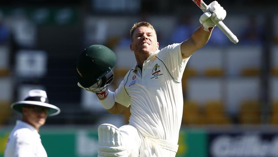 Australia's David Warner celebrates after scoring 100 runs during their cricket test match against Pakistan in Brisbane.