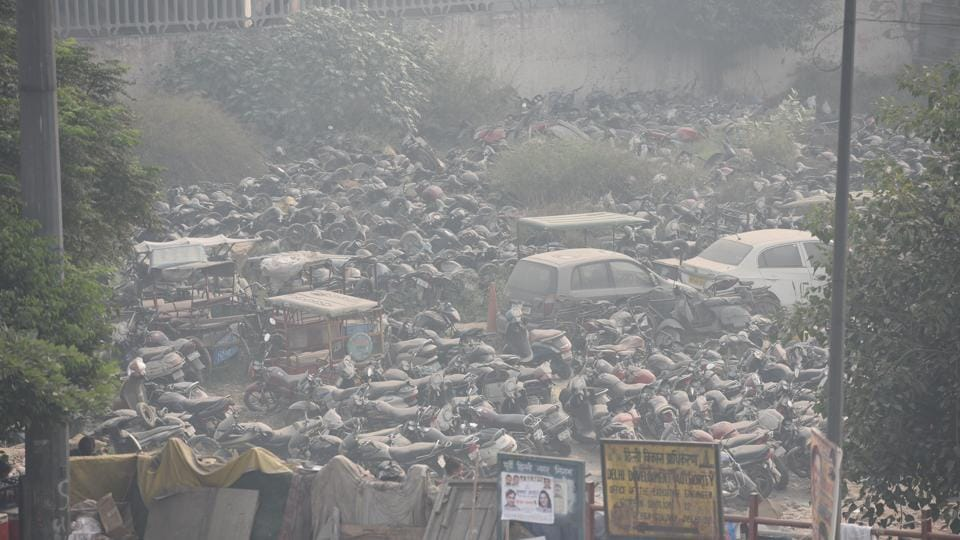 Vehicles in a parking lot during haze and smoggy weather at Shastri Park in New Delhi, on Thursday, November 21, 2019.