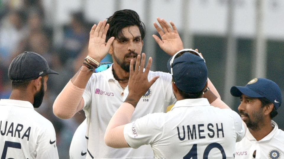 Indian bowler Ishant Sharma celebrates with Umesh Yadav.
