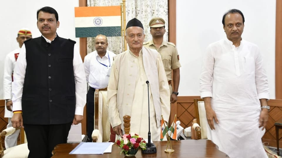 Devendra Fadnavis and Ajit Pawar with Maharashtra Governor  Bhagat Singh Koshyari at the oath-taking ceremony at the Raj Bhawan inMumbai on Saturday.