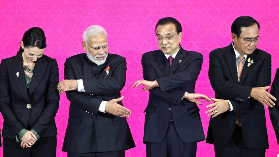 New Zealand's Prime Minister Jacinda Ardern, India's Prime Minister Narendra Modi, Chinese Premier Li Keqiang and Thai Prime Minister Prayuth Chan-Ocha shake hands at the 3rd Regional Comprehensive Economic Partnership (RCEP) summit in Bangkok.