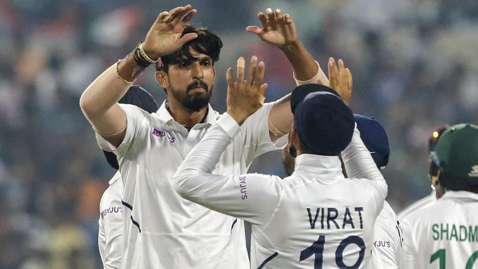 India's Ishant Sharma, left, and Virat Kohli celebrate.