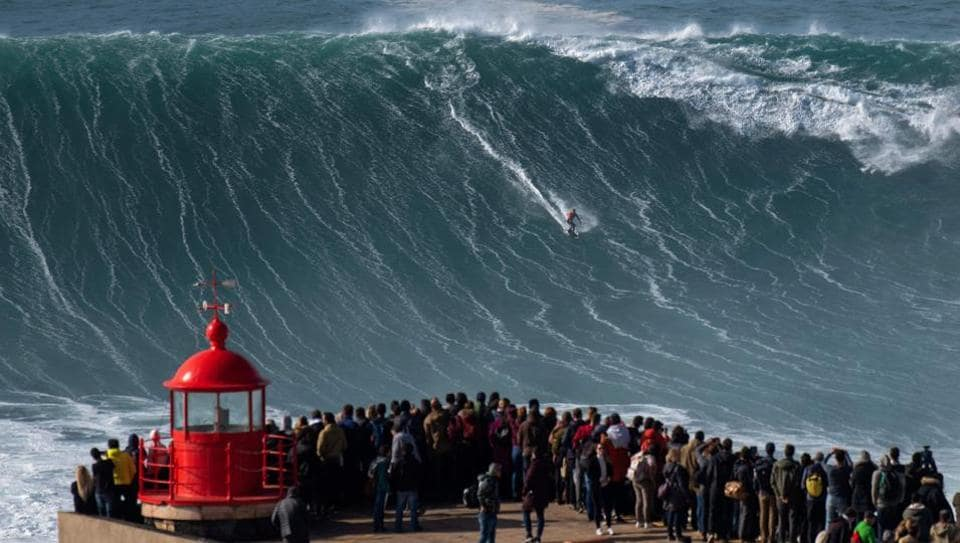 Brazilian surfer Rodrigo Koxa rides a wave during a free surfing session in Nazare, Portugal. Big wave surfers have been flocking to this formerly sleepy Portuguese fishing town, chasing monster waves that are some of the highest ever surfed. Nazare hosts one the two big waves surfing contest in the world, with waves reaching up to 30 metre during winter time. (Olivier Morin / AFP)