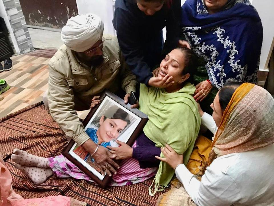 Relatives consoling Prabhleen Kaur's mother Manjit Kaur after the family was informed about her murder in Canada on Sunday.