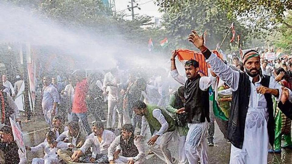 Police personnel use water cannons to disperse Congress workers during a rally in Patna, Bihar, on Sunday.