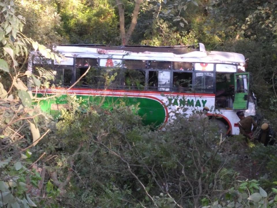 The bus after it fell into the gorge in Kangra district on Monday afternoon.