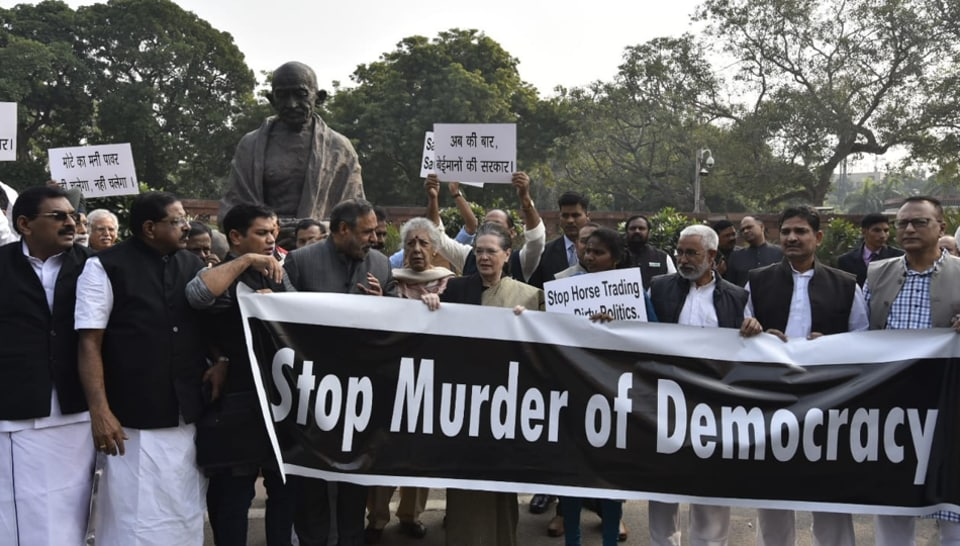 Congress President Sonia Gandhi with senior party leaders leads a protest against Maharashtra government formation issue, at Parliament premises in New Delhi, Monday, Nov. 25, 2019.