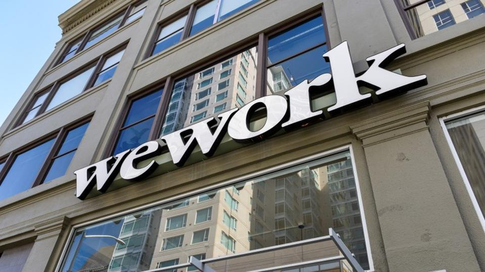 A WeWork logo is seen outside its offices in San Francisco, California, U.S.