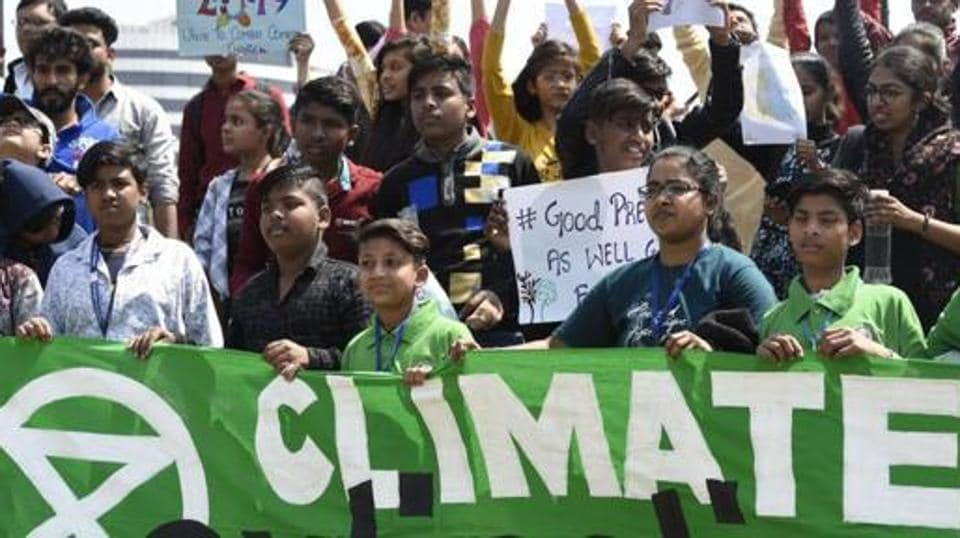 Schoolchildren hold placards as they participate in a protest against the inaction to curb global warming and climate change, Connaught Place, New Delhi, March 15, 2019