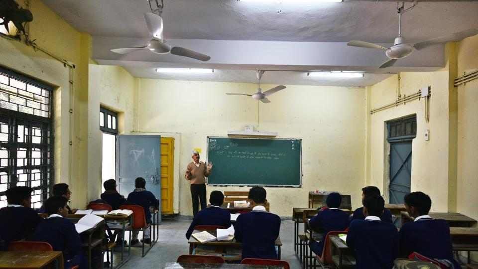 Students said they had complained about the 'shiksha mitra' to the school staff but no action was taken in the matter.
