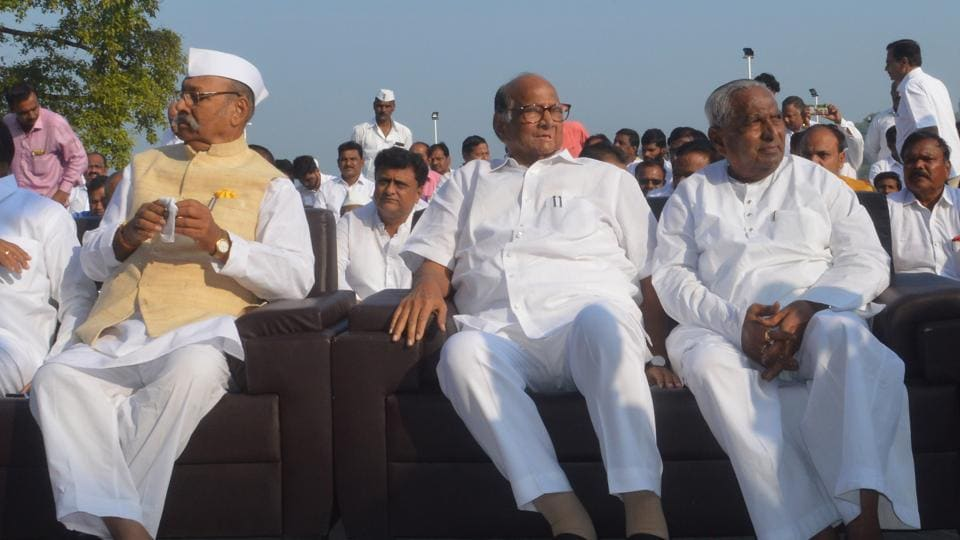 NCP President Sharad Pawar, MP Shrinivas Patil (left), and MLA Balasaheb Patil (right) at the samadhi of Maharashtra's first chief minister, the late Yashwantrao Chavan, on the occasion of his 35th death anniversary in Karad on Monday.
