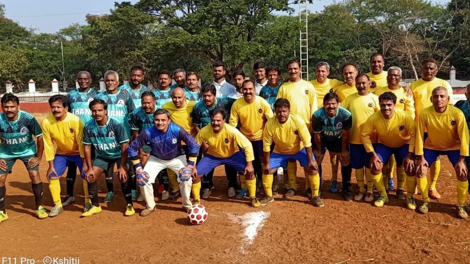 Runners-up Pune players in yellow jersey with winners Thane.